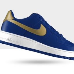 royal blue nike casual shoes with white soles and a gold swoosh