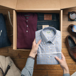 man putting neatly folded dress shirt into drawer