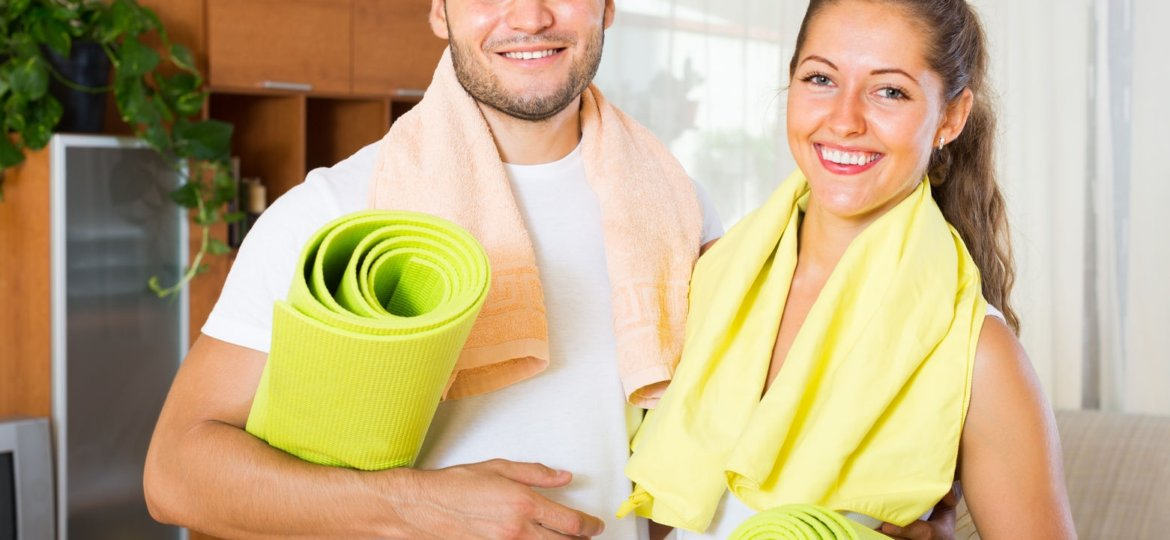 Man and woman with yoga mats