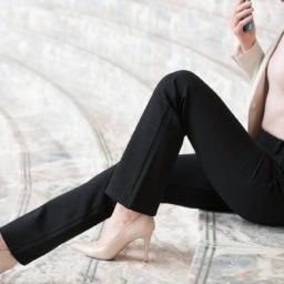 Woman putting on stretch leggings