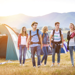 45742535 - group of beautiful teens arriving at summer festival